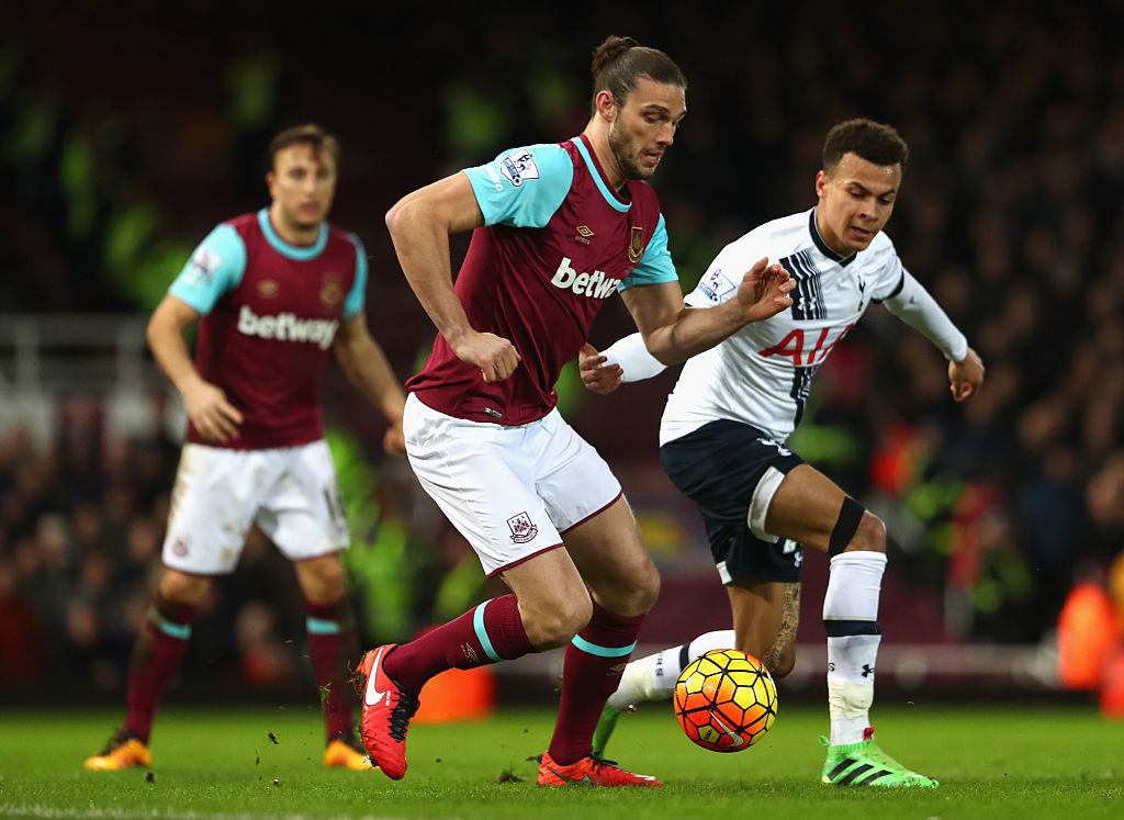 LONDON, ENGLAND - MARCH 02: Andy Carroll of West Ham United and Dele Alli of Tottenham Hotspur challenge for the ball during the Barclays Premier League match between West Ham United and Tottenham Hotspur at Boleyn Ground on March 2, 2016 in London, England.  (Photo by Julian Finney/Getty Images)