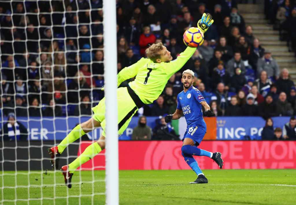 LEICESTER, ENGLAND - JANUARY 01:  Riyad Mahrez of Leicester City scores the opening goal during the Premier League match between Leicester City and Huddersfield Town at The King Power Stadium on January 1, 2018 in Leicester, England.  (Photo by Clive Mason/Getty Images)
