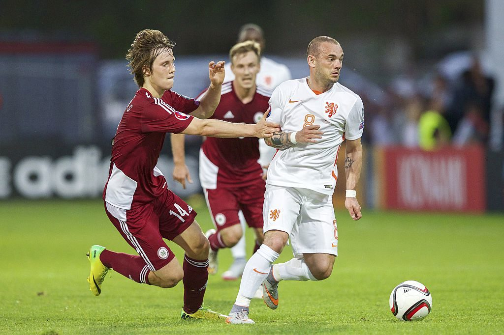 (L-R) Janis Ikaunieks of Latvia, Wesley Sneijder of Holland during the UEFA EURO 2016 qualifying match between Latvia and The Netherlands on June 12, 2015 at the Skonto stadium in Riga, The Netherlands.(Photo by VI Images via Getty Images)