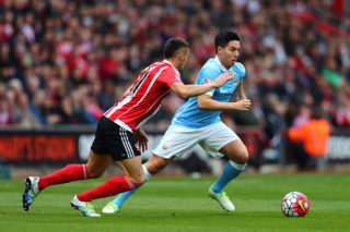 SOUTHAMPTON, ENGLAND - MAY 01:  Samir Nasri of Manchester City takes on Dusan Tadic of Southampton during the Barclays Premier League match between Southampton and Manchester City at St Mary's Stadium on May 1, 2016 in Southampton, England.  (Photo by Clive Rose/Getty Images)