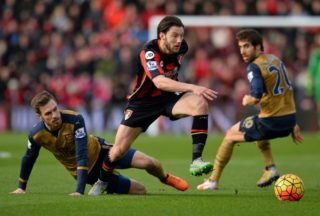 Bournemouth's English-born Irish midfielder Harry Arter (C) vies with Arsenal's Welsh midfielder Aaron Ramsey (L) and Arsenal's French midfielder Mathieu Flamini during the English Premier League football match between Bournemouth and Arsenal at the Vitality Stadium in Bournemouth, southern England on February 7, 2016. / AFP PHOTO / GLYN KIRK / RESTRICTED TO EDITORIAL USE. No use with unauthorized audio, video, data, fixture lists, club/league logos or 'live' services. Online in-match use limited to 75 images, no video emulation. No use in betting, games or single club/league/player publications.  /