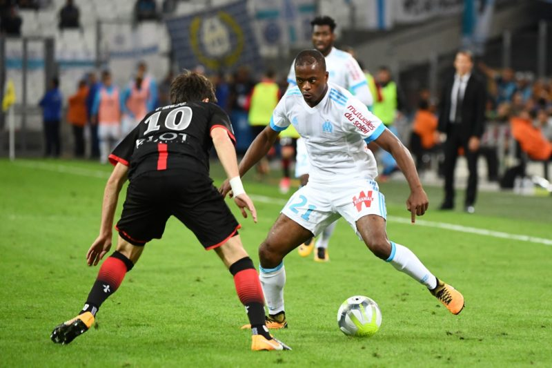 Marseille's French defender Patrice Evra (R) fights for the ball with Rennes' French midfielder Sanjin Prcic (L) during the French L1 football match Olympique of Marseille (OM) versus Stade Rennais FC at the Velodrome stadium in Marseille on September 10, 2017. / AFP PHOTO / BORIS HORVAT