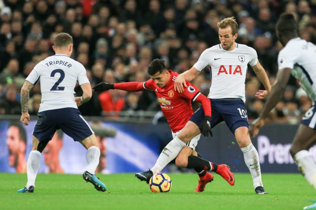 Harry Kane of Tottenham Hotspur tackles Manchester United Forward Alexis Sanchez during the Premier League match between Tottenham Hotspur and Manchester United at Wembley Stadium, London, England on January 31, 2018 - Photo by Phil Duncan / ProSportsImages / DPPI