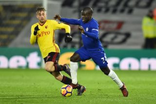 Watford's Spanish midfielder Gerard Deulofeu (L) vies with Chelsea's French midfielder N'Golo Kante during the English Premier League football match between Watford and Chelsea at Vicarage Road Stadium in Watford, north of London on February 5, 2018. / AFP PHOTO / Glyn KIRK / RESTRICTED TO EDITORIAL USE. No use with unauthorized audio, video, data, fixture lists, club/league logos or 'live' services. Online in-match use limited to 75 images, no video emulation. No use in betting, games or single club/league/player publications.  /
