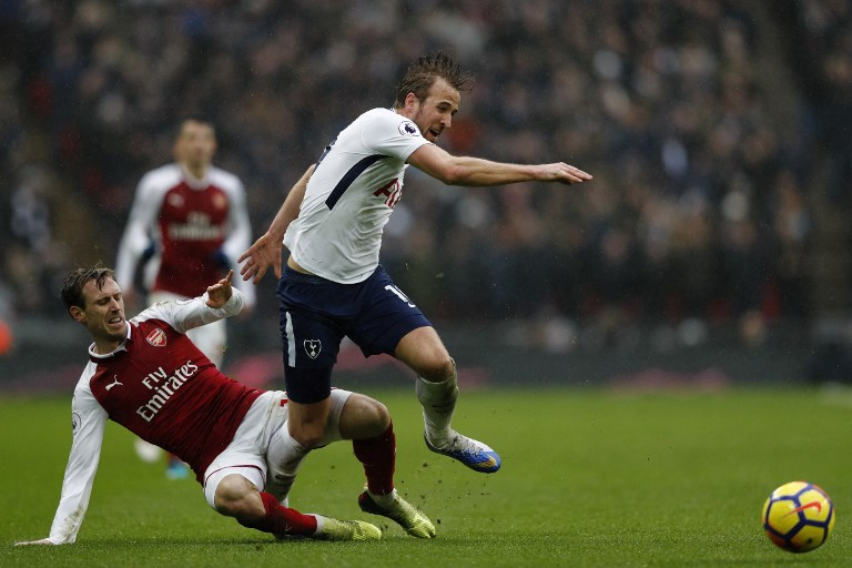 Arsenal's Spanish defender Nacho Monreal (L) tackles Tottenham Hotspur's English striker Harry Kane (R) during the English Premier League football match between Tottenham Hotspur and Arsenal at Wembley Stadium in London, on February 10, 2018. / AFP PHOTO / Adrian DENNIS / RESTRICTED TO EDITORIAL USE. No use with unauthorized audio, video, data, fixture lists, club/league logos or 'live' services. Online in-match use limited to 75 images, no video emulation. No use in betting, games or single club/league/player publications.  /
